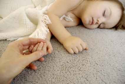 girl sleeping on carpet