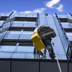 Climber Wash Glass Facade